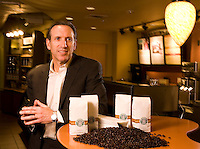 Starbucks CEO Howard Schultz poses for photographs in a mock storefront at Starbucks headquarters in Seattle Tuesday March 18, 2008.