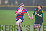 Soracha Feelin of Carrickonsuir races away from Castleislands Ciara Griffin playing for Fermoy at the Girls Munster Rugby blitz last Saturday afternoon in The Grove, Abbeyfeale.