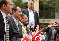 October 2, 2011  (Washington, DC)  District of Columbia Mayor Vincent Gray (seated, center) attended the Turkish Festival in Washington with Turkish Ambassador Tan (left) and Ankara, Turkey, Mayor Melih Gökcek (seated right).    (Photo by Don Baxter/Media Images International)