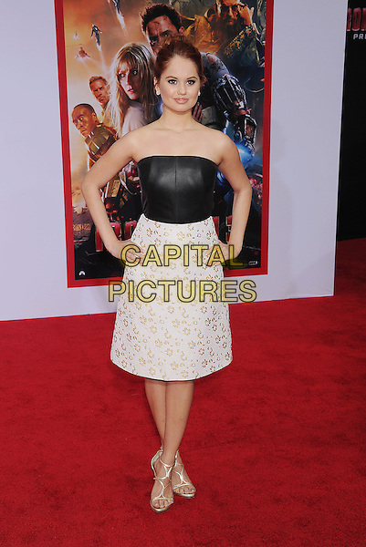 """Debby Ryan.The Los Angeles Premiere of """"Iron Man 3"""" at El Capitan Theatre in Hollywood, California, USA..April 24th, 2013.full length black white strapless dress top skirt gold leather pattern hands on hips.CAP/ROT/TM.©Tony Michaels/Roth Stock/Capital Pictures"""