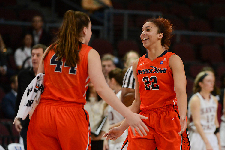March 6, 2014; Las Vegas, NV, USA; Pepperdine Waves guard Allie Green (22) celebrates with forward Kelsey Brockway (44) against the Santa Clara Broncos during the second half of the WCC Basketball Championships at Orleans Arena. The Waves defeated the Broncos 80-74.