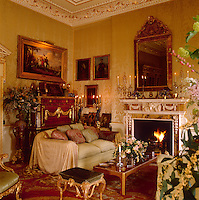 The opulently furnished living room, papered with patterned silk and decorated with gilded paintwork