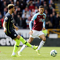 Manchester City's Kyle Walker passes despite the attentions of Burnley's Dwight McNeil<br /> <br /> Photographer Rich Linley/CameraSport<br /> <br /> The Premier League - Burnley v Manchester City - Sunday 28th April 2019 - Turf Moor - Burnley<br /> <br /> World Copyright © 2019 CameraSport. All rights reserved. 43 Linden Ave. Countesthorpe. Leicester. England. LE8 5PG - Tel: +44 (0) 116 277 4147 - admin@camerasport.com - www.camerasport.com