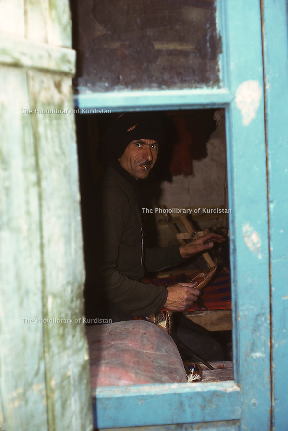 Iran 1975.Mahabad: Man in his workshop weaving