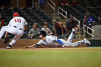 Glendale Desert Dogs Omar Estevez (7) attempts to slide under the tag of Scottsdale Scorpions relief pitcher Brandon White (18) during an Arizona Fall League game on September 20, 2019 at Salt River Fields at Talking Stick in Scottsdale, Arizona. Scottsdale defeated Glendale 3-2. (Zachary Lucy/Four Seam Images)