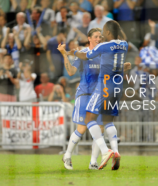 SO KON PO, HONG KONG - JULY 30: Fernando Torres and Didier Drogba of Chelsea celebrates Torres' goal against Aston Villa during the Asia Trophy Final match at the Hong Kong Stadium on July 30, 2011 in So Kon Po, Hong Kong.  Photo by Victor Fraile / The Power of Sport Images