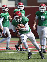 NWA Democrat-Gazette/ANDY SHUPE<br /> Arkansas quarterback Brandon Allen keeps the ball Tuesday, Aug. 11, 2015, during practice at the university's practice field in Fayetteville.
