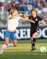 Sonia Bompastor #8 of the Washington Freedom goes for the ball with Sue Weber #20 of the Boston Breakers during a WPS match at the Maryland Soccerplex, in Boyd's, Maryland, on April 18 2009. Breakers won the match 3-1.