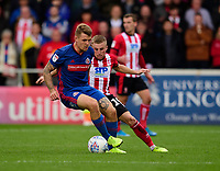 Sunderland's Max Power shields the ball from Lincoln City's Joe Morrell<br /> <br /> Photographer Andrew Vaughan/CameraSport<br /> <br /> The EFL Sky Bet League One - Lincoln City v Sunderland - Saturday 5th October 2019 - Sincil Bank - Lincoln<br /> <br /> World Copyright © 2019 CameraSport. All rights reserved. 43 Linden Ave. Countesthorpe. Leicester. England. LE8 5PG - Tel: +44 (0) 116 277 4147 - admin@camerasport.com - www.camerasport.com