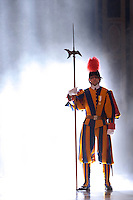 Pontifical Swiss Guard.The Corps of the Pontifical Swiss Guard or Swiss Guard,Guardia Svizzera Pontificia,responsible for the safety of the Pope, including the security of the Apostolic Palace. It serves as the de facto military of Vatican City..Pope Benedict XVI arrives to celebrate a Mass in memory of the late Pope John Paul II on the second anniversary of his death, at St. Peter's Basilica at the Vatican, Monday, April 2, 2007. Roman Catholics marked the second anniversary of Pope John Paul II's death Monday with vigils in his native Poland and a ceremony earlier in Rome to seal shut - with red ribbons and wax - documents on the pope's life that are vital to making him a saint..06/04/2009