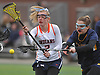 Katie Bellucci #2 of Manhasset, left, and Micayla Brady #18 of Massapequa battle for possession during a Nassau County varsity girls lacrosse game at Manhasset High School on Tuesday, March 27, 2018. Manhasset won by a score of 11-8.
