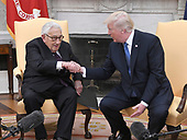 United States President Donald J. Trump shakes hands with former US Secretary of State Dr. Henry Kissinger in the Oval Office of the White House in Washington, DC on Tuesday, October 10, 2017.  During the photo-op the President took some questions from reporters.<br /> Credit: Ron Sachs / CNP