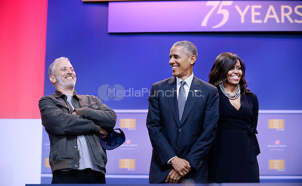 Comedian Jon Stewart shares a laugh with United States President Barack Obama and First Lady Michelle Obama at the kick off of the 5th anniversary of Joining Forces and the 75th anniversary of the USO at Joint Base Andrews on May 5, 2016 in Maryland. <br /> Credit: Olivier Douliery / Pool via CNP/MediaPunch