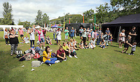 Pictured: People watch a performance on stage Saturday 13 August 2016<br />Re: Grow Wild event at  Furnace to Flowers site in Ebbw Vale, Wales, UK