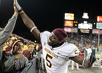 spt-asuua 112910226tmk --ASU's LeQuan Lewis high fives ASU fans after beating Arizona in double overtime during Thursday's Territorial Cup in Tucson.  (Pat Shannahan/ The Arizona Republic)