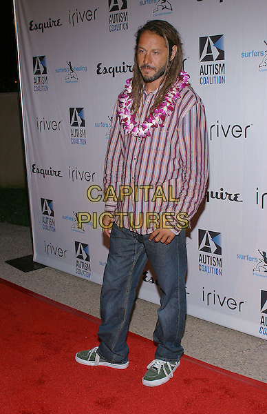 TONY ALVA.Endless Summer Party To Benefit The Autism Coalition and Surfers Healing held at the Esquire House. .September 30, 2004.Photo by V. Summers/AdMedia. .full length, stripes, flowers, garland, necklace, jeans, denim.www.capitalpictures.com.sales@capitalpictures.com.© Capital Pictures.