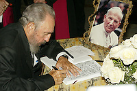 HAVANA, CUBA: April 4, 2005.- Former Cuban President Fidel Castro signed the &quot;Book of Condolences&quot; at the headquarters of the Catholic Nunciature in Havana for the death of Pope John Paul II.<br /> The Cuban Cardinal Jaime Ortega, who with Pope Francisco helped the restoration of relations between Cuba and the United States. Ortega will leave the leadership of the Catholic Church on the island, said Vatican. . Credit: Jorge Rey/MediaPunch