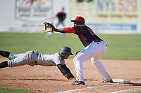 Batavia Muckdogs first baseman Lazaro Alonso (19) stretches for a throw as Sandy Santos (27) dives back to the bag during a game against the West Virginia Black Bears on June 25, 2017 at Dwyer Stadium in Batavia, New York.  Batavia defeated West Virginia 4-1 in nine innings of a scheduled seven inning game.  (Mike Janes/Four Seam Images)