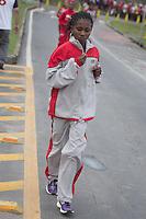 BELO HORIZONTE, MG - 01.12.2013 - XV VOLTA INTERNACIONAL DA PAMPULHA - Aquecimento da atleta do Quenia na XV Volta Internacional da Pampulha, neste domingo (01), <br /> a corrida tem um percurso de 18 km (Foto: Marcos Fialho/Brazil Photo Press)