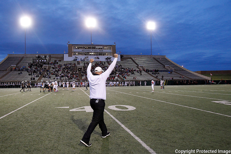 Saginaw Boswell head coach John Abendschand celebrates their 20-10 win against Lubbock Cooper in the 5A Division II Region I semi-final high school football playoff at Memorial Stadium in Wichita Falls on Saturday, November 26, 2016.