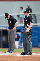 Umpires Mark Bass (left) and Mike Stover prior to the start of the Appalachian League game between the Pulaski Yankees and the Danville Braves at American Legion Post 325 Field on July 31, 2016 in Danville, Virginia.  The Yankees defeated the Braves 8-3.  (Brian Westerholt/Four Seam Images)