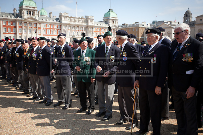 11/07/2013. London, UK. British veterans of the Korean War are seen on Horse Guards Parade in London today (11/07/2013) as they prepare to march to Westminster Abbey. The parade and service held to commemorate the 60th Anniversary of the end of the Korean War, often known as the 'Forgotten War', which saw a United Nations force of many nations fight against North Korean and Chinese forces trying to invade South Korea. Photo credit: Matt Cetti-Roberts