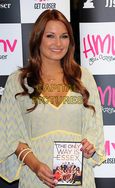 "Sam Faiers .Signing copies of the new ""The Only Way is Essex"" DVD, HMV, Westfield, Stratford, East London, England..29th September 2011.TOWIE half length blue yellow zig zag dress.CAP/CJ.©Chris Joseph/Capital Pictures."