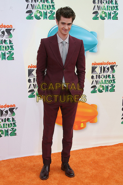 Andrew Garfield.2012 Nickelodeon Kids' Choice Awards held at the Galen Center, Los Angeles, California, USA, 31st March 2012..full length red burgundy suit jacket hands in pockets grey gray shirt suit tie .CAP/ADM.©AdMedia/Capital Pictures.
