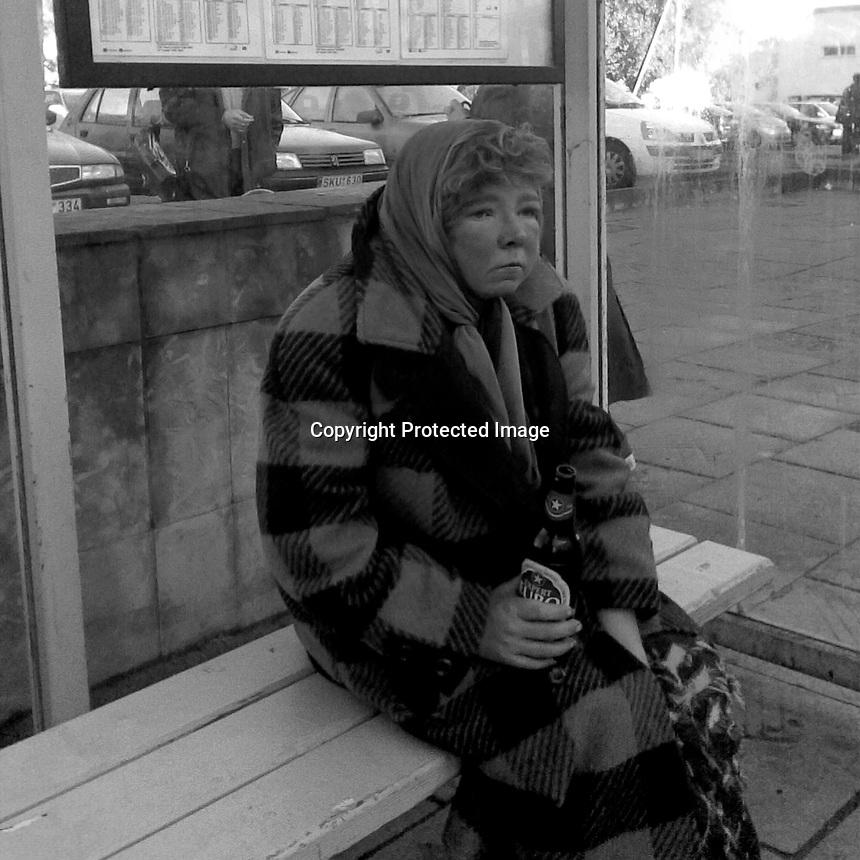 Lithuania, Kaunas. Woman drinking