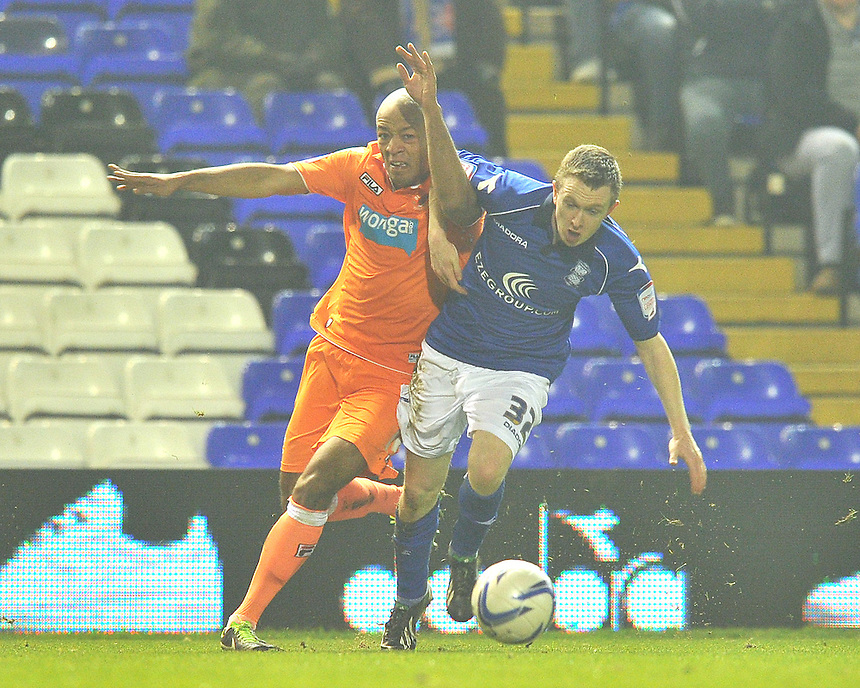 Blackpool's Thomas Ince and Birmingham City's Shane Ferguson battle for the ball..Football - npower Football League Championship - Birmingham City v Blackpool - Tuesday 05th March 2013 - St Andrews - Birmingham..© CameraSport - 43 Linden Ave. Countesthorpe. Leicester. England. LE8 5PG - Tel: +44 (0) 116 277 4147 - admin@camerasport.com - www.camerasport.com