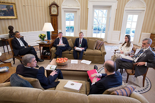 United States President Barack Obama meets with National Security staff in the Oval Office, March 8, 2012. From left are: Douglas E. Lute, Senior Director for Afghanistan and Pakistan; Jeff Eggers, Director for Afghanistan and Central Region; David Holmes Director for Afghanistan; National Security Advisor Tom Donilon; Avril Haines, Deputy Counsel to the President; and Deputy National Security Advisor Denis McDonough. .Mandatory Credit: Pete Souza - White House via CNP