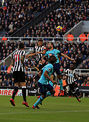 4th November 2017, St James Park, Newcastle upon Tyne, England; EPL Premier League football, Newcastle United Bournemouth; Dwight Gayle of Newcastle United heads for goal in spite of Steve Cook of AFC Bournemouth efforts with Joselu of Newcastle United and Nathan Aké of AFC Bournemouth close by