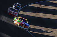 Mar 2, 2008; Las Vegas, NV, USA; NASCAR Sprint Cup Series driver Kyle Busch (18) leads Kasey Kahne and Denny Hamlin during the UAW Dodge 400 at Las Vegas Motor Speedway. Mandatory Credit: Mark J. Rebilas-US PRESSWIRE