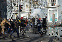 Protesters fight  throwing paving stones towards the police. Kiev, Ukraine
