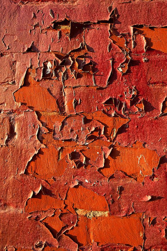 Peeling brick wall.