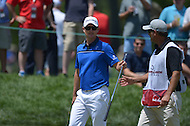 Bethesda, MD - June 28, 2014: Justin Rose finishes hole 7 in Round 3 of the Quicken Loans National at the Congressional Country Club in Bethesda, MD, June 28, 2014.  (Photo by Don Baxter/Media Images International)