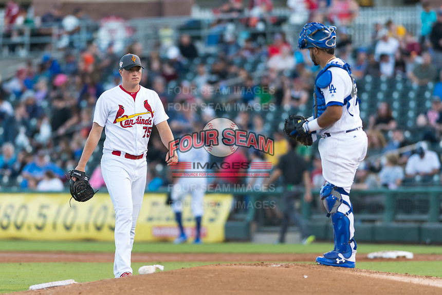 AFL West relief pitcher Evan Kruczynski (75), of the Surprise Saguaros and St. Louis Cardinals organization, walks towards the mound where catcher Keibert Ruiz (17) waits during a pitching change in the Arizona Fall League Fall Stars game at Surprise Stadium on November 3, 2018 in Surprise, Arizona. The AFL West defeated the AFL East 7-6 . (Zachary Lucy/Four Seam Images)