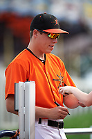 Frederick Keys pitcher James Teague (32) signing autographs for fans before the first game of a doubleheader against the Lynchburg Hillcats on June 13, 2018 at Nymeo Field at Harry Grove Stadium in Frederick, Maryland.  Frederick defeated Lynchburg 3-0.  (Mike Janes/Four Seam Images)