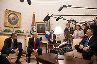 United States President Donald J. Trump, second left, answers a reporter's question as he meets with Prime Minister Kyriakos Mitsotakis of Greece, left, first lady Melania Trump, center right, and US Secretary of State Mike Pompeo, right, in the Oval Office of the White House in Washington, D.C. on Tuesday, January 7, 2020.    <br /> Credit: Tasos Katopodis / Pool via CNP/AdMedia