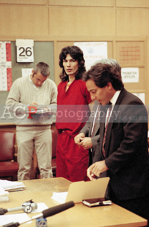 May 29, 1991 - San Francisco, California, USA - Richard Ramirez, center, stands between his attorneys in a San Francisco courtroom May 29, 1991. Ramirez was convicted of 13 sex slayings the mid-1980s. Attorneys are unidentified..(Credit Image: © Alan Greth/Alan Greth)