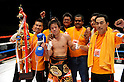Tomonobu Shimizu (JPN),  Kentaro Kaneko,  Kenji Kaneko,  Yuji Iida, AUGUST 31, 2011 - Boxing : Tomonobu Shimizu of Japan wearing his champion poses with Kaneko boxing gym president Kentaro Kaneko (2nd R), manager and trainer Kenji Kaneko (R) and trainer Yuji Iida (L) after winning the WBA super flyweight title bout at Nippon Budokan in Tokyo, Japan. (Photo by Mikio Nakai/AFLO)