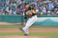 Michael Brady (26) of the Salt Lake Bees delivers a pitch to the plate against the Fresno Grizzlies at Smith's Ballpark on May 25, 2014 in Salt Lake City, Utah.  (Stephen Smith/Four Seam Images)