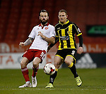 John Brayford of Sheffield Utd tussles with Stuart Beavon of Burton Albion - English League One - Sheffield Utd vs Burton Albion - Bramall Lane Stadium - Sheffield - England - 1st March 2016 - Pic Simon Bellis/Sportimage