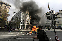 Pictured: A rubbish bin and other items are set alight by protesters  Friday 12 February 2016<br /> Re: Violent clashes between farmers and riot police outside the Ministry of Agricultural Development in Athens, Greece. The farmers travelled from Crete to protest against pension and welfrae reforms proposed by the Greek government,
