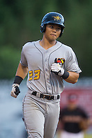 Connor Joe (23) of the West Virginia Power hustles towards third base against the Kannapolis Intimidators at Intimidators Stadium on July 3, 2015 in Kannapolis, North Carolina.  The Intimidators defeated the Power 3-0 in a game called in the bottom of the 7th inning due to rain.  (Brian Westerholt/Four Seam Images)
