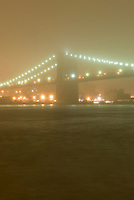 Brooklyn Bridge and East River on a Foggy Night, Viewed from Manhattan looking towards Brooklyn, New York City, New York State, USA