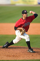 Kannapolis Intimidators relief pitcher Israel Chirino winds up to deliver the ball to the plate versus the Augusta Green Jackets at Fieldcrest Cannon Stadium in Kannapolis, NC, Sunday, June 18, 2006.