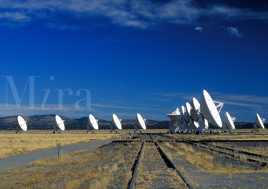 Very Large Array (VLA). Tracks in foreground are for moving the antenna.  several satellite antenna dishes. New Mexico, Plains of San Agustin.