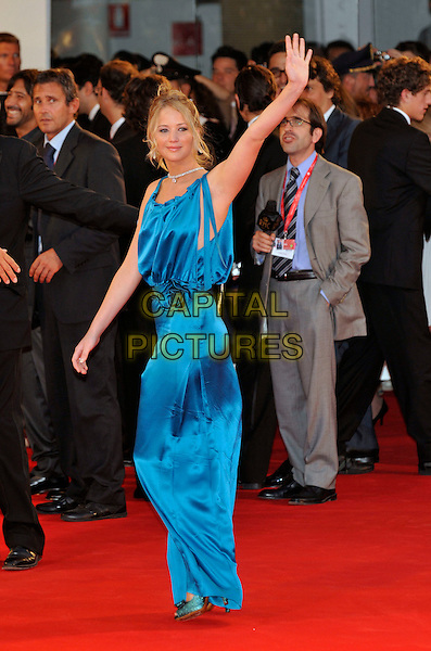 "JENNIFER LAWRENCE .Red Carpet arrivals for ""The Burning Plain"" premiere held at the Sala Grande during the 65th Venice Film Festival, .full length  long blue silk satin dress maxi hand waving green bow shoes .CAP/PL.© Phil Loftus/Capital Pictures"