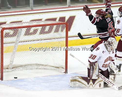 Katharine Chute (Harvard - 15) celebrates her goal which tied the game at 1 just 36 seconds after BC scored. - The Boston College Eagles defeated the Harvard University Crimson 3-1 to win the 2011 Beanpot championship on Tuesday, February 15, 2011, at Conte Forum in Chestnut Hill, Massachusetts.